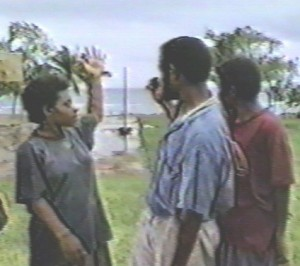 young lady describes flight of ropen, probably at Lab Lab, Umboi Island