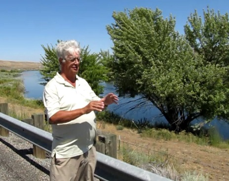 Peter Beach tells Whitcomb about how the light flew up from this tree on night, by the Yakima River in Washington