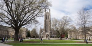 students and others walk in front of the Duke Chapel